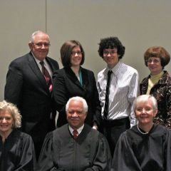 New admittee Colette Willer with her family and the justices.