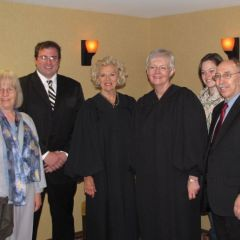 New admittee  Mike Welsh-Phillips with his family and Justices Burke and Theis