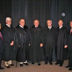 Justices and speakers for the Fifth District ceremony in Collinsville. ISBA Secretary Carl Draper is at the far right.