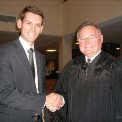 Justice Lloyd A. Karmeier congratulates new admittee Jason C. Dupont from Des Peres, Mo.