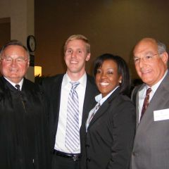New admittees Tameeka L. Purchase and Gary S. Peeples (center) visit with Justice Lloyd A. Karmeier (left) and ISBA President Mark D. Hassakis after being sworn in at the 5th District Ceremony