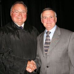 New admittee Thomas Mathews of Lee Summit, MO with Justice Karmeier.  Not only is Mr. Mathews a new lawyer, he is also a Doctor of Osteopathic Medicine.