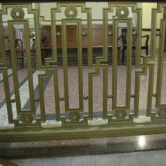 You have to look closely to notice the now-stigmatized shape in the bannister throughout the courthouse.
