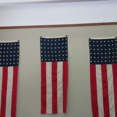 Three flags from the celebration still fly in the Circuit Clerk's office.