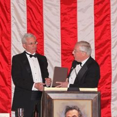 """ISBA President O'Brien presents """"The Papers of Abraham Lincoln"""" to Peoria County Bar President Timothy J. Cassidy."""