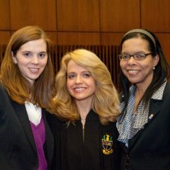 Chapter Justice Michele Jochner congratulates two new Phi Alpha Delta members and active ISBA members Laura Milnichuk (left) and Yolaine Dauphin.