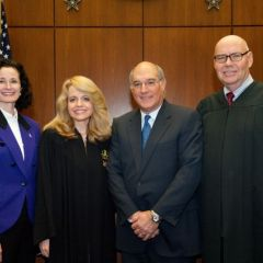 Fraternity initiates Jayne Reardon (left), Executive Director of the Illinois Supreme Court's Commission on Professionalism and Mark Hassakis (2nd from right), President-Elect of the Illinois State Bar Association, are congratulated by Michele Jochner, Chicago Alumni Chapter Justice and Chief Judge James F. Holderman, Honorary Board Chair of the Chicago Alumni Chapter.