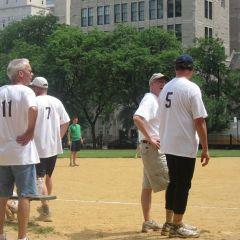 ISBA Board members talk strategy before the game.