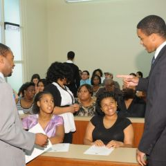 Teachers Tyreese Foreman and Terrance Garmon chat with students