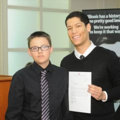 Thomas Roche Jr. receives the Achievement Award from teacher Phillip Rutherford