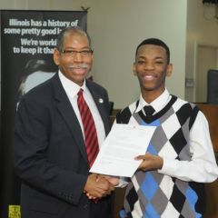 Dean Rory Smith presents a Moot Court award to David McNeal