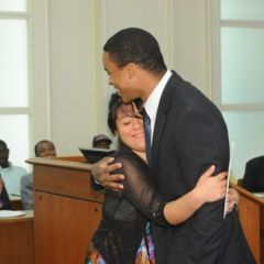 Teacher Terrance Garmon gets a hug from Lincoln Award winner Esperanza Gaytan