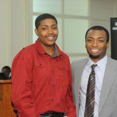 Sidney Butler (left) accepts the Thurgood Marshall Award from teacher Tyreese Foreman