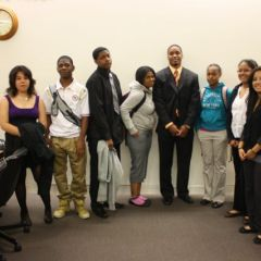 Teacher Terrance Garmon (4th from left) with students in the Daley Center.