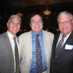 ISBA Board member Stephen Komie (center) and friends