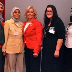 Amina Saeed (in yellow), President of the Muslim Bar Association of Chicago, along with fellow members, visits with Lilly Ledbetter