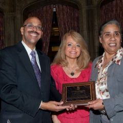 Pierre Priestley and Michele Jochner present a Chicago Alumni Chapter Centennial Award to past Chapter Justice, Hon. Julie-April Montgomery