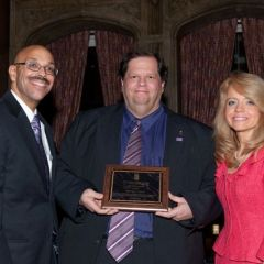 Pierre Priestley and Michele Jochner present a Chicago Alumni Chapter Centennial Award to past Chapter Justice, BJ Maley