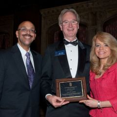 Pierre Priestley and Michele Jochner present a Chicago Alumni Chapter Centennial Award to past Chapter Justice, John K. Norris