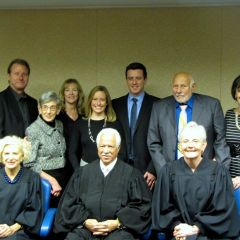 New admittee Jonathon Walton and family with Justices Burke, Freeman and Theis