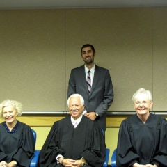New admittee Andrew Bashi with Justices Burke, Freeman and Theis