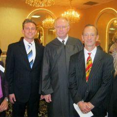 Speaker and ISBA Board member Sonni Williams, new admittee Carmen Rossi, Chief Justice Thomas L. Kilbride, father Judge Raymond Rossi and Judge Sara L. Darrow.
