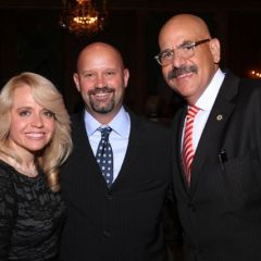 Honorees Michele Jochner and Judge William Hooks visit with Shawn Kasserman (center).