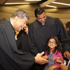 Chief Cook County Circuit Court Judge Timothy C. Evans greets Armaan, 9, as his sister, 5-year-old Sarina, and his father, Judge Mohammed M. Ghouse look on. Judge Ghouse was one of 13 associate judges sworn in Monday, May 9, 2016, at an event held in the James R. Thompson Center.