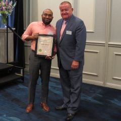 Cory White, Board of Governors Award recipient, and President Russell Hartigan