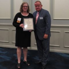Kathryn Kelly, Austin Fleming Newsletter Editor Award recipient, andPresident Russell Hartigan