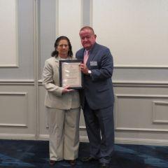 Lynn Patton, Austin Fleming Newsletter Editor Award recipient,and President Russell Hartigan