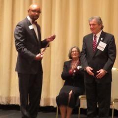 Vincent Cornelius present Joseph Gagliardo his award