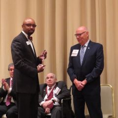 Vincent Cornelius presents James Holderman his award