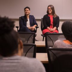 Maliha Siddiqui and Jenna DiJohn speak to an audience of law students at DePaul University College of Law.