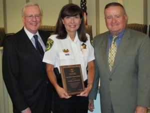 Western Springs Police Chief Pamela Church (center) received the 2009 Law Enforcement Award from the Illinois State Bar Association (ISBA) Monday evening, June 8, during a ceremony at the Western Springs village hall. ISBA President-elect John G. O'Brien (left) and Russell W. Hartigan, a Chicago attorney and ISBA board member who resides in Western Springs, presented the award.